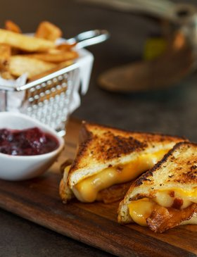 Delicious cheesy grilled cheese on sourdough with berry compote